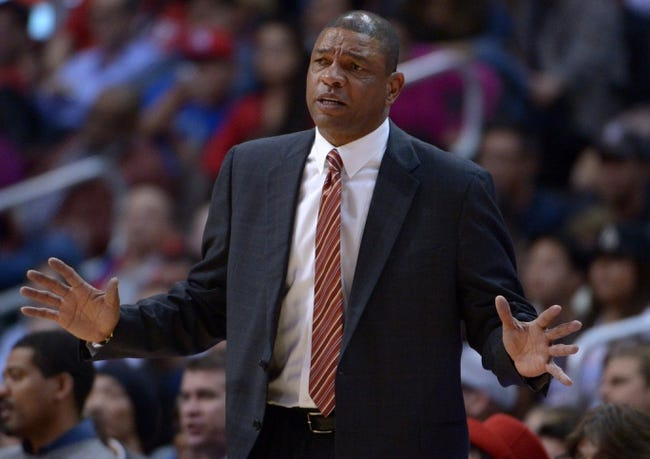 Dec 16, 2013; Los Angeles, CA, USA; Los Angeles Clippers coach Doc Rivers reacts during the game against the San Antonio Spurs at Staples Center. The Clippers defeated the Spurs 115-92. Mandatory Credit: Kirby Lee-USA TODAY Sports