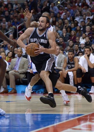 Dec 16, 2013; Los Angeles, CA, USA; San Antonio Spurs guard Manu Ginobili (20) dribbles the ball against the Los Angeles Clippers at Staples Center. The Clippers defeated the Spurs 115-92. Mandatory Credit: Kirby Lee-USA TODAY Sports