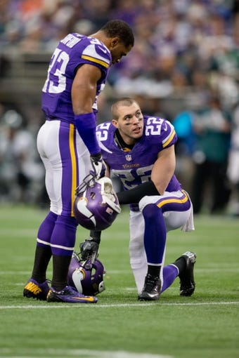 Dec 15, 2013; Minneapolis, MN, USA; Minnesota Vikings safety Harrison Smith (22) talks with safety Jamarca Sanford (33) during a timeout in the game with the Philadelphia Eagles at Mall of America Field at H.H.H. Metrodome. The Vikings win 48-30. Mandatory Credit: Bruce Kluckhohn-USA TODAY Sports