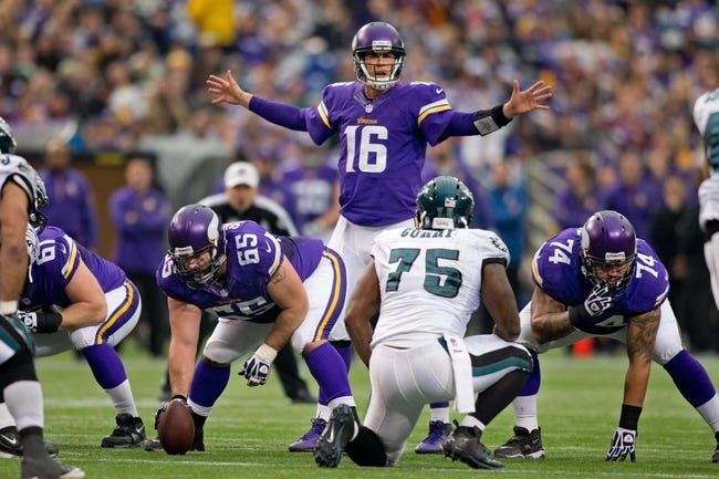 Dec 15, 2013; Minneapolis, MN, USA; Minnesota Vikings quarterback Matt Cassel (16) talks to his offense in preparation for a play against the Philadelphia Eagles in the second quarter at Mall of America Field at H.H.H. Metrodome. The Vikings win 48-30. Mandatory Credit: Bruce Kluckhohn-USA TODAY Sports
