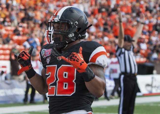 Dec 24, 2013; Honolulu, HI, USA; Oregon State Beavers running back Terron Ward (28) reacts after scoring a second quarter touchdown against the Boise State Broncos at the 2013 Hawaii Bowl at Aloha Stadium. Mandatory Credit: Marco Garcia-USA TODAY Sports