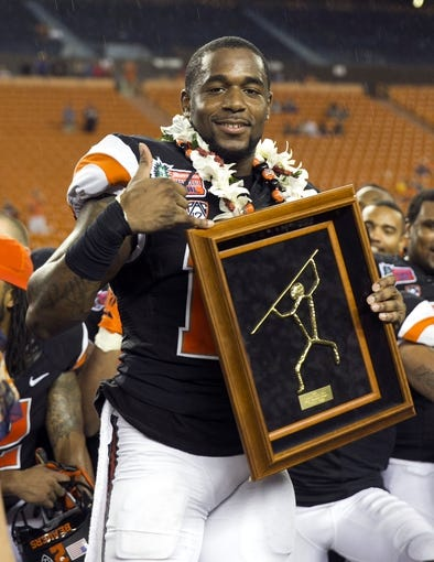 Dec 24, 2013; Honolulu, HI, USA; Oregon State Beavers cornerback Rashaad Reynolds (16) holds the MVP trophy after the the 2013 Hawaii Bowl against the Boise State Broncos at Aloha Stadium. Mandatory Credit: Marco Garcia-USA TODAY Sports