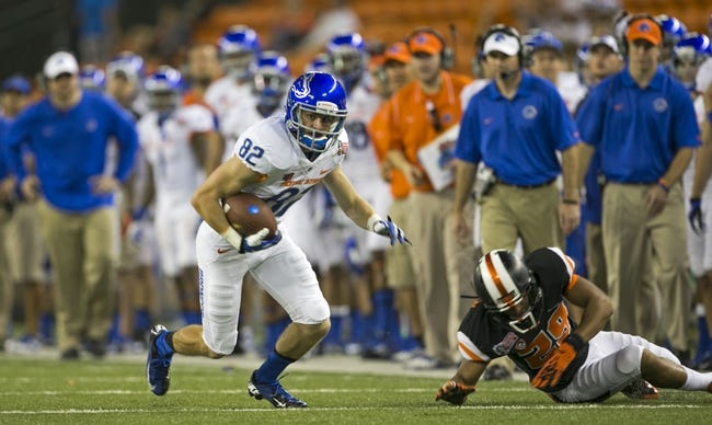 Dec 24, 2013; Honolulu, HI, USA; Oregon State Beavers safety Steven Christian (29) avoids the tackle attempt by Boise State Broncos wide receiver Thomas Sperbeck (82) in the fourth quarter at the 2013 Hawaii Bowl at Aloha Stadium. Mandatory Credit: Marco Garcia-USA TODAY Sports