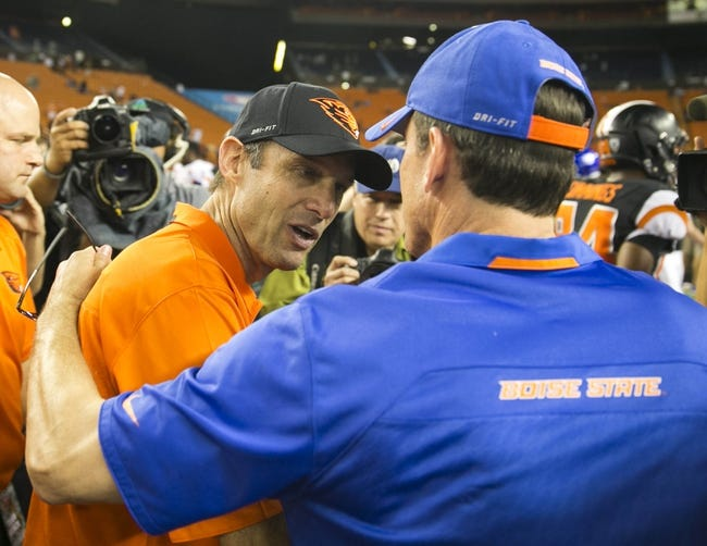 Dec 24, 2013; Honolulu, HI, USA; Oregon State Beavers head coach Mike Riley (left) greets  Boise State Broncos head coach Bob Gregory after the 2013 Hawaii Bowl at Aloha Stadium. Mandatory Credit: Marco Garcia-USA TODAY Sports
