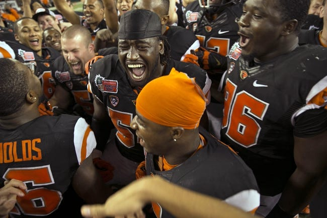 Dec 24, 2013; Honolulu, HI, USA; Oregon State Beavers players celebrate after the 2013 Hawaii Bowl against the Boise State Broncos at Aloha Stadium. Mandatory Credit: Marco Garcia-USA TODAY Sports