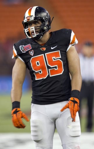 Dec 24, 2013; Honolulu, HI, USA; Oregon State Beavers defensive end Scott Crichton (95) on the field during the fourth quarter during the game against Boise State Broncos at the 2013 Hawaii Bowl at Aloha Stadium. Mandatory Credit: Marco Garcia-USA TODAY Sports