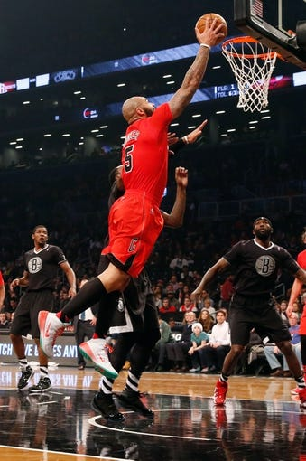 Dec 25, 2013; Brooklyn, NY, USA;  Chicago Bulls power forward Carlos Boozer (5) shoots during the second quarter against the Brooklyn Nets at Barclays Center. Mandatory Credit: Anthony Gruppuso-USA TODAY Sports