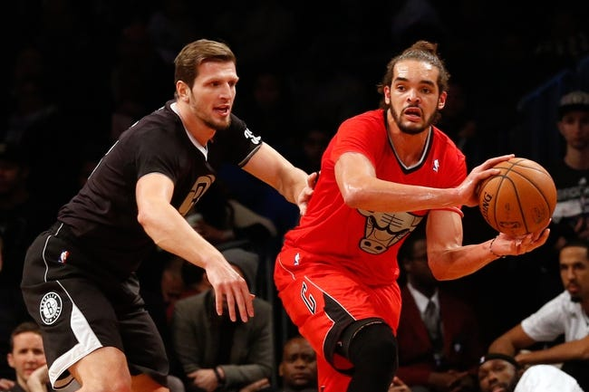 Dec 25, 2013; Brooklyn, NY, USA;  Chicago Bulls center Joakim Noah (13) passes around Brooklyn Nets power forward Mirza Teletovic (33) during the third quarter at Barclays Center. Chicago Bulls won 95-78.  Mandatory Credit: Anthony Gruppuso-USA TODAY Sports