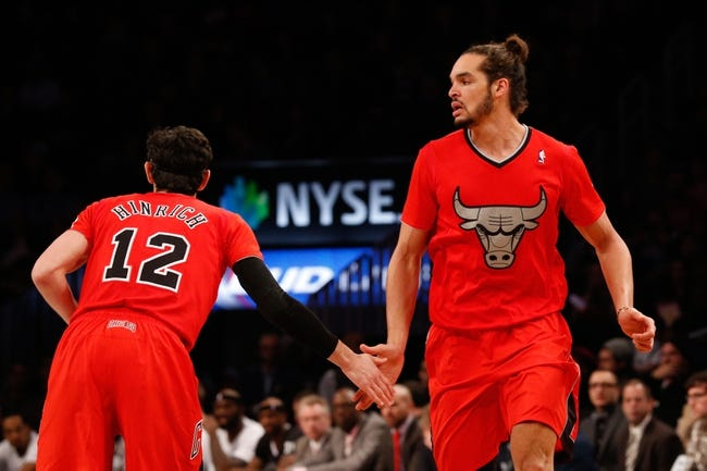 Dec 25, 2013; Brooklyn, NY, USA;  Chicago Bulls shooting guard Kirk Hinrich (12) high fives center Joakim Noah (13) during the third quarter against the Brooklyn Nets at Barclays Center. Chicago Bulls won 95-78.  Mandatory Credit: Anthony Gruppuso-USA TODAY Sports