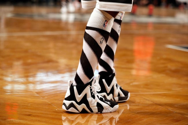 Dec 25, 2013; Brooklyn, NY, USA;  Detailed view of the socks and sneakers of Brooklyn Nets shooting guard Jason Terry (31) during the third quarter against the Chicago Bulls at Barclays Center. Chicago Bulls won 95-78.  Mandatory Credit: Anthony Gruppuso-USA TODAY Sports