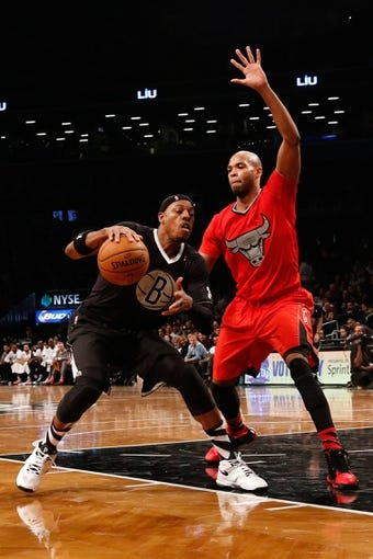 Dec 25, 2013; Brooklyn, NY, USA;  Chicago Bulls power forward Taj Gibson (22) defends Brooklyn Nets small forward Paul Pierce (34) during the fourth quarter at Barclays Center. Chicago Bulls won 95-78.  Mandatory Credit: Anthony Gruppuso-USA TODAY Sports