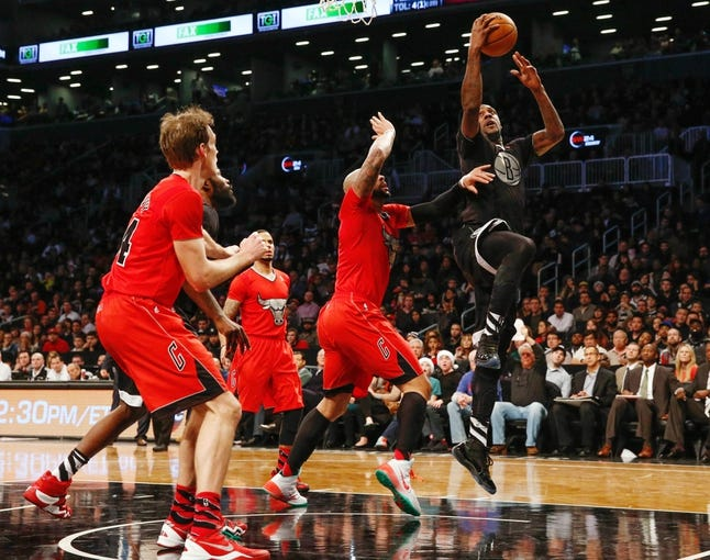 Dec 25, 2013; Brooklyn, NY, USA; Brooklyn Nets center Andray Blatche (0) drives to the net during the third quarter against the Chicago Bulls at Barclays Center. Chicago Bulls won 95-78.  Mandatory Credit: Anthony Gruppuso-USA TODAY Sports