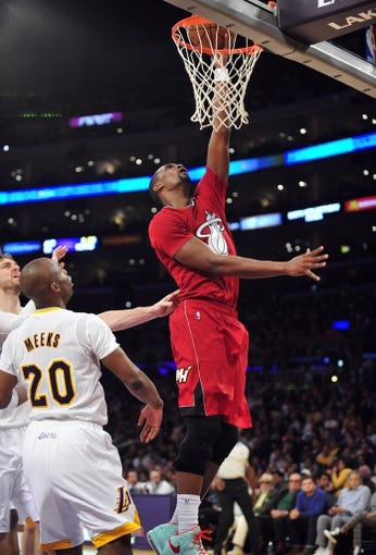 December 25, 2013; Los Angeles, CA, USA; Miami Heat center Chris Bosh (1) dunks to score a basket against the Los Angeles Lakers during the first half at Staples Center. Mandatory Credit: Gary A. Vasquez-USA TODAY Sports