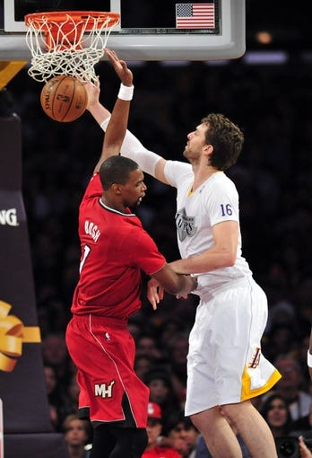 December 25, 2013; Los Angeles, CA, USA; Miami Heat center Chris Bosh (1) scores a basket against the defense of Los Angeles Lakers center Pau Gasol (16) during the second half at Staples Center. Mandatory Credit: Gary A. Vasquez-USA TODAY Sports