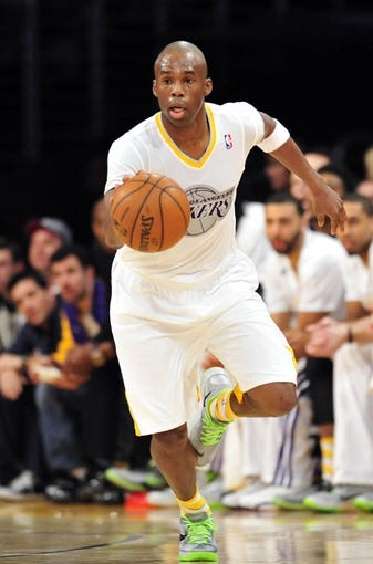 December 25, 2013; Los Angeles, CA, USA; Los Angeles Lakers shooting guard Jodie Meeks (20) moves the ball up court against the Miami Heat during the second half at Staples Center. Mandatory Credit: Gary A. Vasquez-USA TODAY Sports