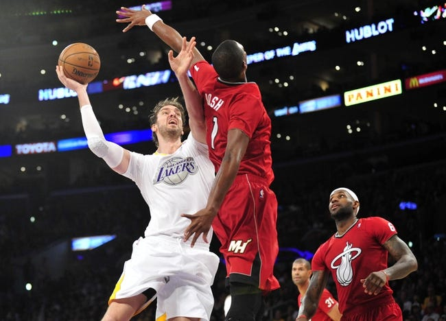 December 25, 2013; Los Angeles, CA, USA; Los Angeles Lakers center Pau Gasol (16) moves to the basket against the defense of Miami Heat center Chris Bosh (1) during the second half at Staples Center. Mandatory Credit: Gary A. Vasquez-USA TODAY Sports