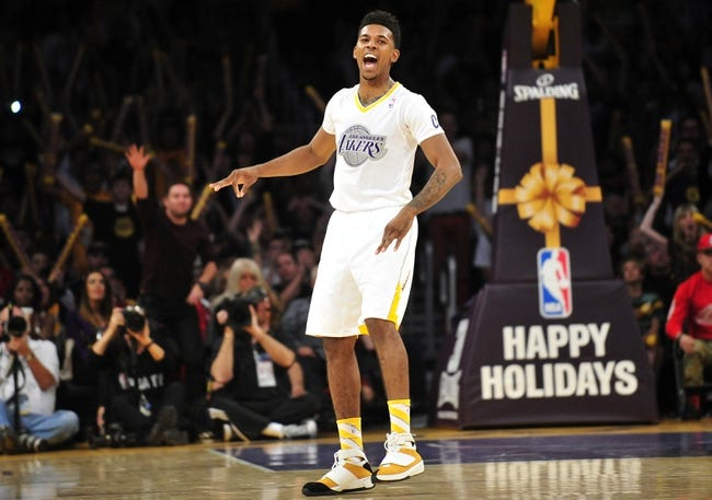 December 25, 2013; Los Angeles, CA, USA; Los Angeles Lakers small forward Nick Young (0) reacts after scoring a three point basket against the Miami Heat during the second half at Staples Center. Mandatory Credit: Gary A. Vasquez-USA TODAY Sports