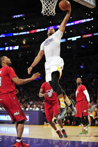 December 25, 2013; Los Angeles, CA, USA; Los Angeles Lakers small forward Xavier Henry (7) goes in for a basket against the Miami Heat during the second half at Staples Center. Mandatory Credit: Gary A. Vasquez-USA TODAY Sports