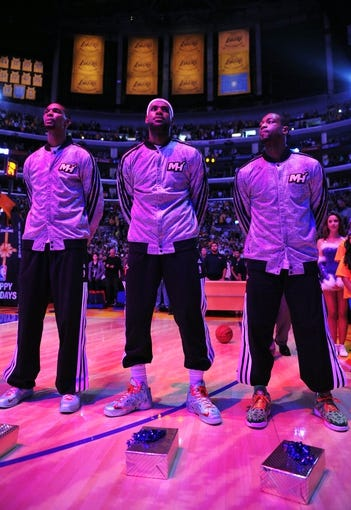 December 25, 2013; Los Angeles, CA, USA; Miami Heat center Chris Bosh (1), small forward LeBron James (6) and shooting guard Dwyane Wade (3) before playing against the Los Angeles Lakers at Staples Center. Mandatory Credit: Gary A. Vasquez-USA TODAY Sports