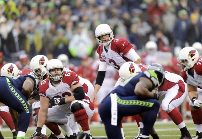 Dec 22, 2013; Seattle, WA, USA; Arizona Cardinals quarterback Carson Palmer (3) during the game against the Seattle Seahawks at CenturyLink Field. Arizona defeated Seattle 17-10. Mandatory Credit: Steven Bisig-USA TODAY Sports