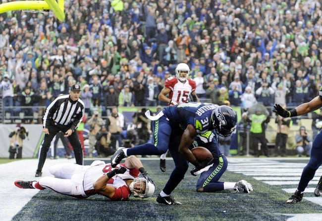 Dec 22, 2013; Seattle, WA, USA; Seattle Seahawks strong safety Kam Chancellor (31) intercepts a pass thrown by Arizona Cardinals quarterback Carson Palmer (not pictured) during the game at CenturyLink Field. Arizona defeated Seattle 17-10. Mandatory Credit: Steven Bisig-USA TODAY Sports