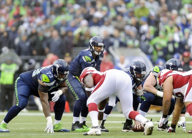 Dec 22, 2013; Seattle, WA, USA; Seattle Seahawks quarterback Russell Wilson (3) at the line of scrimmage during the game against the Arizona Cardinals at CenturyLink Field. Arizona defeated Seattle 17-10. Mandatory Credit: Steven Bisig-USA TODAY Sports