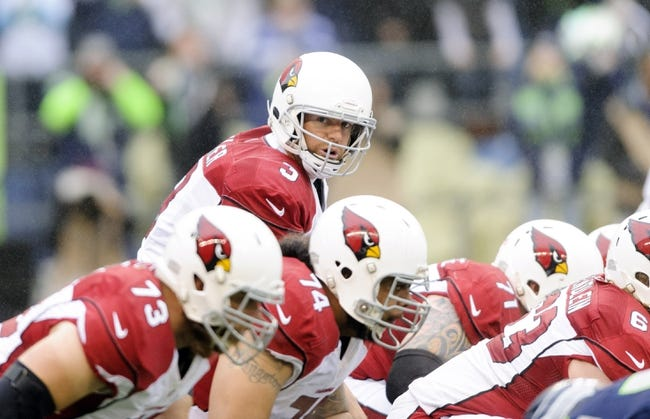 Dec 22, 2013; Seattle, WA, USA; Arizona Cardinals quarterback Carson Palmer (3) at the line of scrimmage during the game against the Seattle Seahawks at CenturyLink Field. Arizona defeated Seattle 17-10. Mandatory Credit: Steven Bisig-USA TODAY Sports