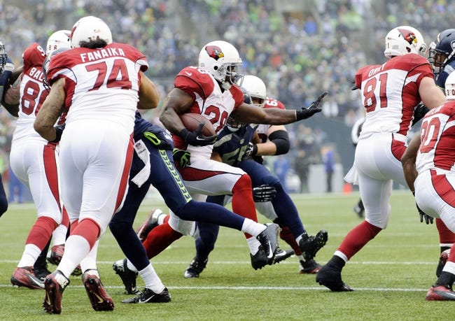 Dec 22, 2013; Seattle, WA, USA; Arizona Cardinals running back Rashard Mendenhall (28) carries the ball against the Seattle Seahawks during the game at CenturyLink Field. Arizona defeated Seattle 17-10. Mandatory Credit: Steven Bisig-USA TODAY Sports