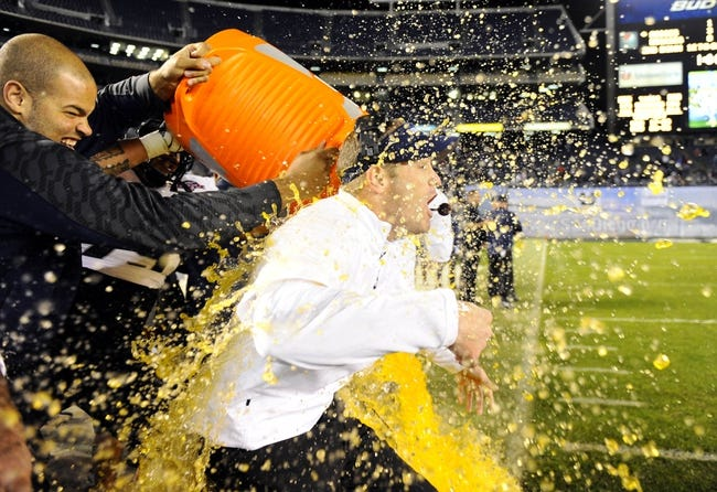 Dec 26, 2013; San Diego, CA, USA; Utah State Aggies head coach Matt Wells is dumped with Gatorade following a win against the Northern Illinois Huskies at Qualcomm Stadium. The Aggies won 21-14. Mandatory Credit: Christopher Hanewinckel-USA TODAY Sports