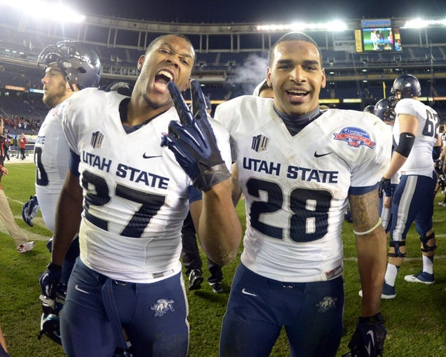 Dec 26, 2013; San Diego, CA, USA; Utah State Aggies running backs Roert Marshall (27) and Joey DeMartino (28) celebrate after the 2013 Poinsettia Bowl against the Northern Illinois Huskies at Qualcomm Stadium. Mandatory Credit: Kirby Lee-USA TODAY Sports