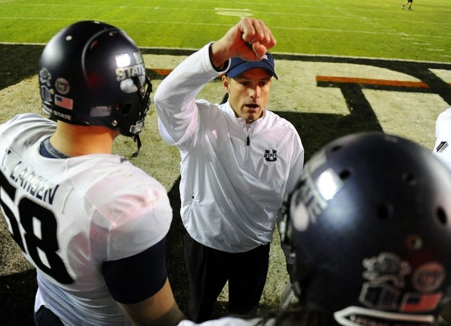 Dec 26, 2013; San Diego, CA, USA; Utah State Aggies head coach Matt Wells talks with his team before the start of the second half against the Northern Illinois Huskies during the 2013 Poinsettia Bowl at Qualcomm Stadium. Mandatory Credit: Christopher Hanewinckel-USA TODAY Sports