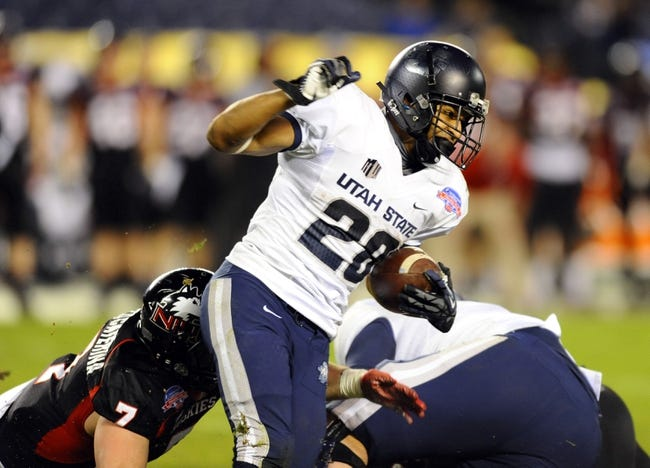 Dec 26, 2013; San Diego, CA, USA; Utah State Aggies running back Joey DeMartino (28) runs for a short gain in the second half against the Northern Illinois Huskies during the 2013 Poinsettia Bowl at Qualcomm Stadium. Mandatory Credit: Christopher Hanewinckel-USA TODAY Sports