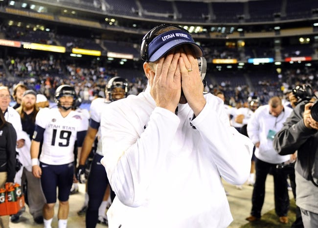 Dec 26, 2013; San Diego, CA, USA; Utah State Aggies head coach Matt Wells  reacts after being dumped with Gatorade in the second half against the Northern Illinois Huskies during the 2013 Poinsettia Bowl at Qualcomm Stadium. The Aggies won 21-14. Mandatory Credit: Christopher Hanewinckel-USA TODAY Sports