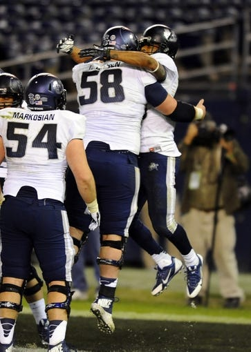 Dec 26, 2013; San Diego, CA, USA; Utah State Aggies running back Joey DeMartino (28) celebrates after a touchdown in the second half against the Northern Illinois Huskies during the 2013 Poinsettia Bowl at Qualcomm Stadium. Mandatory Credit: Christopher Hanewinckel-USA TODAY Sports