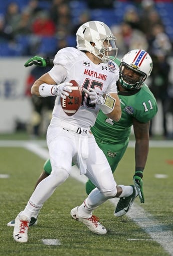 Dec 27, 2013; Annapolis, MD, USA; Marshall Herd lineman James Rouse (11) sacks Maryland Terrapins quarterback C.J. Brown (16) during the 2013 Military Bowl at Navy-Marine Corps Memorial Stadium. Mandatory Credit: Mitch Stringer-USA TODAY Sports