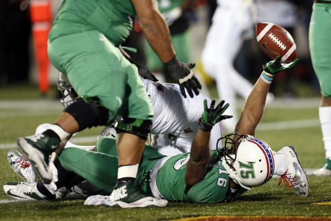 Dec 27, 2013; Annapolis, MD, USA; Marshall Herd running back Essray Taliaferro (16) celebrates his touchdown run against the Maryland Terrapins during the 2013 Military Bowl at Navy-Marine Corps Memorial Stadium. Mandatory Credit: Mitch Stringer-USA TODAY Sports