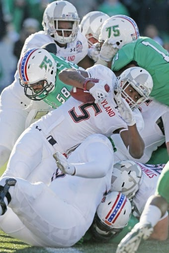 Dec 27, 2013; Annapolis, MD, USA; Maryland Terrapins running back Albert Reid (5) is stopped for no gain by the Marshall Thundering Herd defense during the 2013 Military Bowl at Navy-Marine Corps Memorial Stadium. Mandatory Credit: Mitch Stringer-USA TODAY Sports