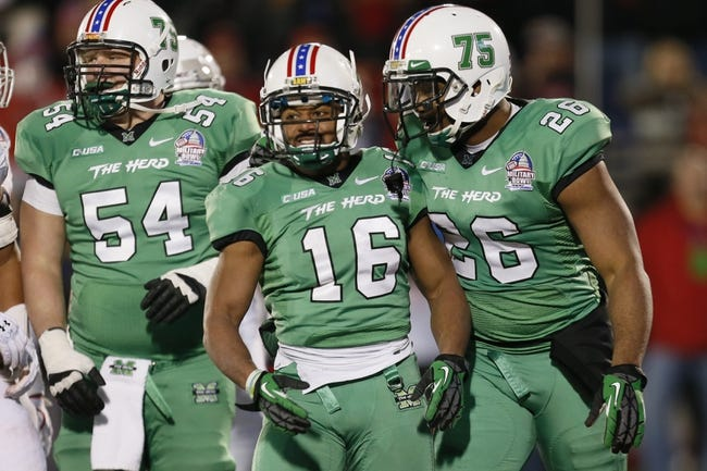 Dec 27, 2013; Annapolis, MD, USA; Marshall Herd running back Essray Taliaferro (16) celebrates his touchdown run against the Maryland Terrapins with lineman Michael Selby (54) and tight end Gator Hoskins (26) during the 2013 Military Bowl at Navy-Marine Corps Memorial Stadium. Mandatory Credit: Mitch Stringer-USA TODAY Sports