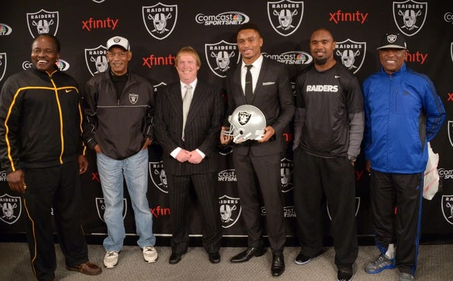 Dec 27, 2013; Alameda, CA, USA; Oakland Raiders former cornerback Nnamdi Asomugha poses at press conference to announce his retirement at Oakland Raiders Practice Facility. From left: Lester Hayes and Willie Brown and Mark Davis and Asomugha and Charles Woodson and Cliff Branch. Mandatory Credit: Kirby Lee-USA TODAY Sports