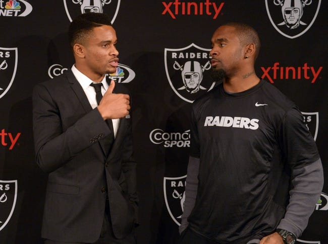 Dec 27, 2013; Alameda, CA, USA; Charles Woodson (right) and Nnamdi Asomugha at press conference at Oakland Raiders Practice Facility. Mandatory Credit: Kirby Lee-USA TODAY Sports