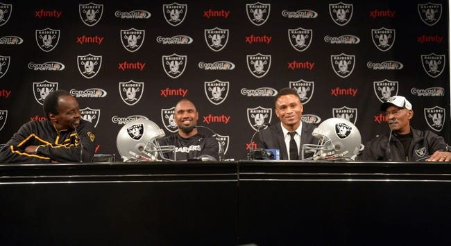 Dec 27, 2013; Alameda, CA, USA; Oakland Raiders former cornerback Nnamdi Asomugha (second from right) at press conference to announce his retirement at Oakland Raiders Practice Facility. From left: Lester Hayes and Charles Woodson and Asomugha and Willie Brown. Mandatory Credit: Kirby Lee-USA TODAY Sports