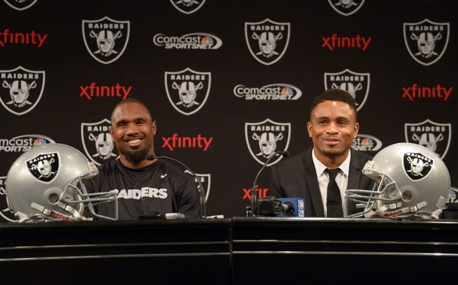 Dec 27, 2013; Alameda, CA, USA; Charles Woodson (left) and Nnamdi Asomugha at press conference at Oakland Raiders Practice Facility. Mandatory Credit: Kirby Lee-USA TODAY Sports