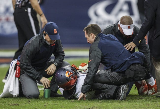 Dec 27, 2013; Houston, TX, USA; Syracuse Orange guard Rob Trudo (55) is evaluated by medical staff during the second quarter of the Texas Bowl against the Minnesota Golden Gophers at Reliant Stadium . Mandatory Credit: Troy Taormina-USA TODAY Sports