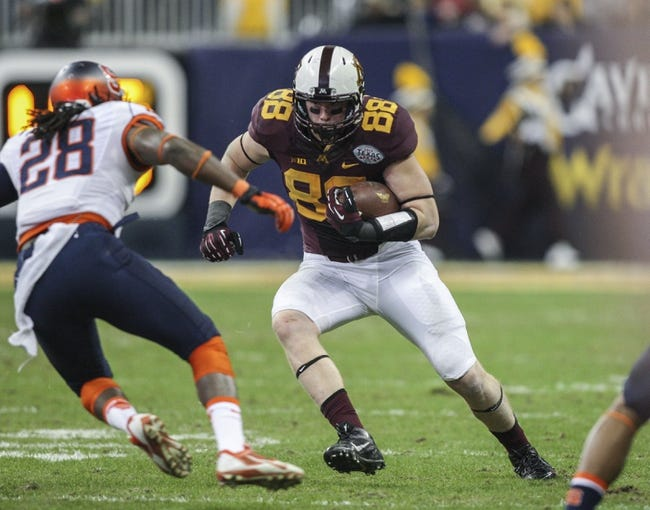 Dec 27, 2013; Houston, TX, USA; Minnesota Golden Gophers tight end Maxx Williams (88) makes a reception during the second quarter of the Texas Bowl as Syracuse Orange safety Jeremi Wilkes (28) attempts to make a tackle at Reliant Stadium . Mandatory Credit: Troy Taormina-USA TODAY Sports