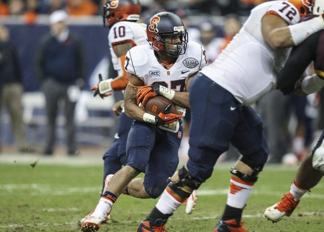 Dec 27, 2013; Houston, TX, USA; Syracuse Orange running back George Morris II (27) rushes during the third quarter of the Texas Bowl against the Minnesota Golden Gophers at Reliant Stadium . Mandatory Credit: Troy Taormina-USA TODAY Sports