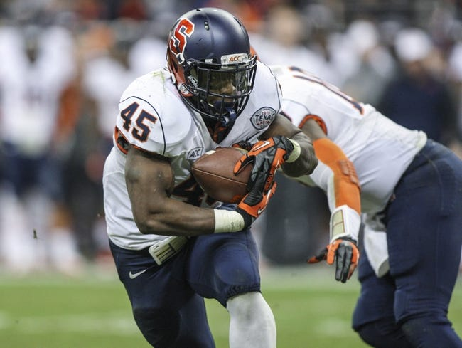 Dec 27, 2013; Houston, TX, USA; Syracuse Orange running back Jerome Smith (45) rushes during the third quarter of the Texas Bowl against the Minnesota Golden Gophers at Reliant Stadium . Mandatory Credit: Troy Taormina-USA TODAY Sports