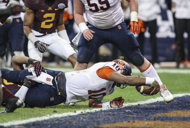Dec 27, 2013; Houston, TX, USA; Syracuse Orange quarterback Terrel Hunt (10) dives for a touchdown during the third quarter of the Texas Bowl against the Minnesota Golden Gophers at Reliant Stadium . Mandatory Credit: Troy Taormina-USA TODAY Sports