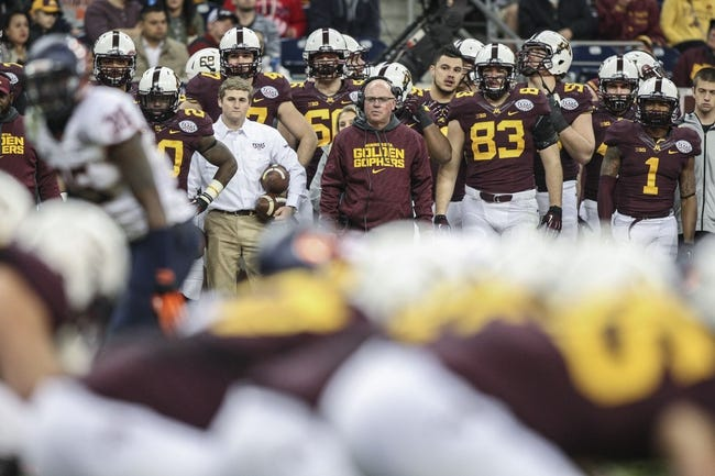 Dec 27, 2013; Houston, TX, USA; Minnesota Golden Gophers head coach Jerry Kill watches from the sideline during the third quarter of the Texas Bowl against the Syracuse Orange at Reliant Stadium . Mandatory Credit: Troy Taormina-USA TODAY Sports