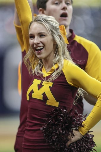 Dec 27, 2013; Houston, TX, USA; A Minnesota Golden Gophers cheerleader performs during the fourth quarter of the Texas Bowl against the Syracuse Orange at Reliant Stadium . Mandatory Credit: Troy Taormina-USA TODAY Sports