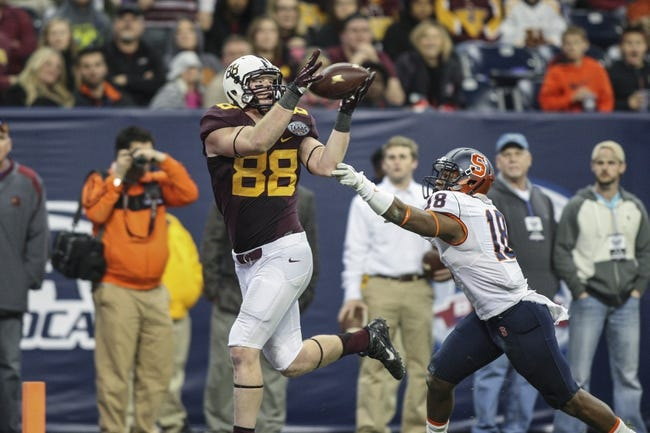 Dec 27, 2013; Houston, TX, USA; Minnesota Golden Gophers tight end Maxx Williams (88) catches a pass for a touchdown during the fourth quarter of the Texas Bowl as Minnesota Golden Gophers linebacker Peter Westerhaus (18) defends at Reliant Stadium . Mandatory Credit: Troy Taormina-USA TODAY Sports